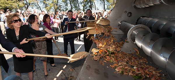 Chancellor Katehi, and others help feed the campus biodigester